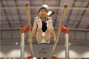 boy gymnast on parallel bars