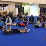 learning gymnastics skills boy in plank partner position