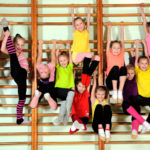 Group of happy kids in the gym